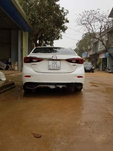 Bán Mazda 3 1.5 năm sản xuất 2015, màu trắng chính chủ