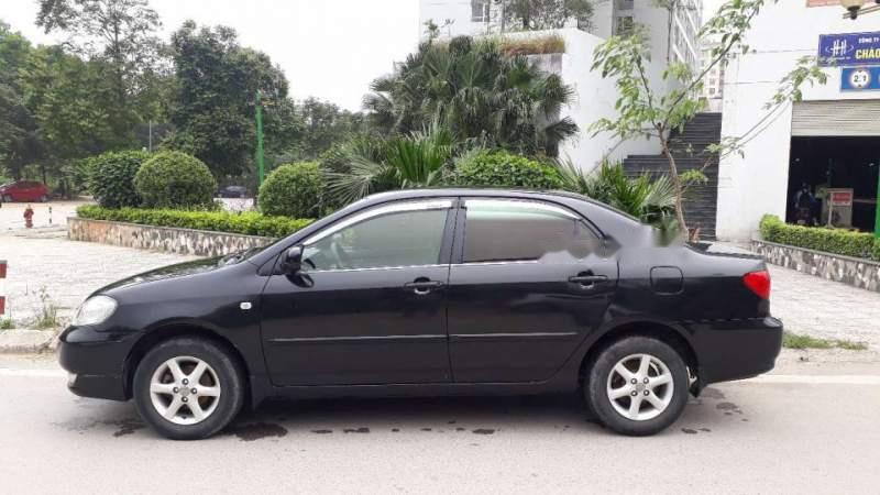 Cần bán gấp Toyota Corolla altis sản xuất năm 2003, màu đen