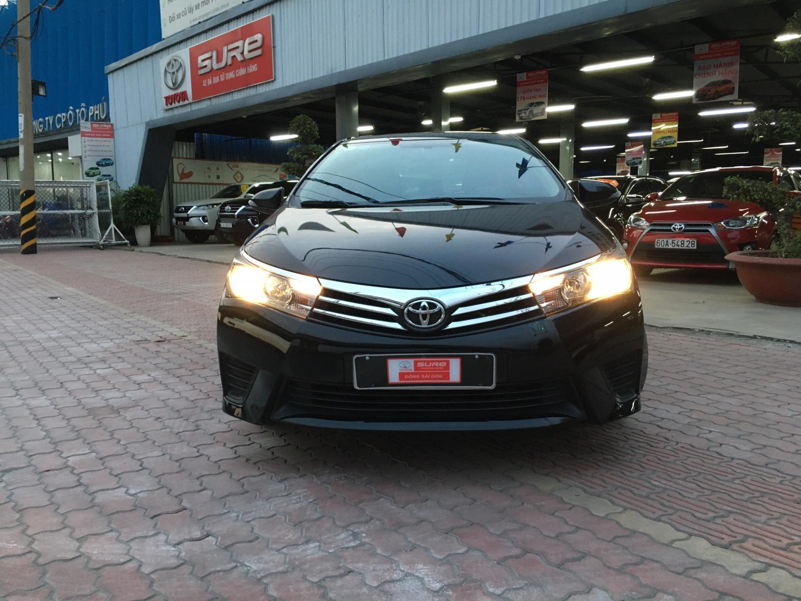 Cần bán gấp Toyota Corolla altis 1.8 MT đời 2014, màu đen Siêu Chất mới chạy 55.000km , giá cạnh tranh