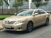 Bán Toyota Camry LE 2.5AT đời 2010, màu vàng, nhập khẩu nguyên chiếc chính chủ giá 920 triệu tại Tp.HCM