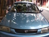 Cần bán gấp Mazda 323 MT sản xuất năm 1997, màu xanh lam giá 80 triệu tại Hòa Bình