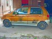 Bán xe Daewoo Matiz đời 2005, màu cam giá 125 triệu tại Tây Ninh