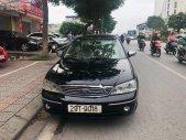 Cần bán xe Ford Laser Ghia 1.8 AT năm sản xuất 2003, màu đen số tự động giá cạnh tranh giá 239 triệu tại Hà Nội