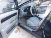 Cần bán xe cũ Daewoo Lacetti sản xuất 2004, màu đen như mới giá 133 triệu tại Ninh Bình