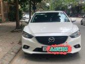 Cần bán gấp Mazda 2 2.0 AT sản xuất năm 2014, màu trắng như mới giá cạnh tranh giá 710 triệu tại Hà Nội