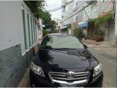 Cần bán Toyota Corolla Altis 2009, số sàn, biển số Tp HCM, màu đen giá 380 triệu tại Tp.HCM