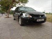 Chính chủ bán xe Mitsubishi Lancer Gala GLX1.6AT năm sản xuất 2004, màu đen giá 210 triệu tại Hà Nội