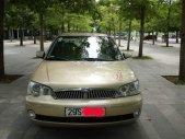 Bán xe Ford Laser đời 2002, màu vàng, giá tốt giá 180 triệu tại Hà Nội