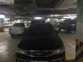 Bán xe Ford Laser Ghia 1.8 AT năm sản xuất 2005, màu đen số tự động giá 265 triệu tại Hà Nội