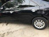 Bán nhanh Toyota Camry 2.0E đời 2010, màu đen, xe gia đình một chút đi, bản full option giá 560 triệu tại Hà Nội