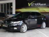 Cần bán xe Kia Forte SX 1.6MT đời 2011, màu đen giá 346 triệu tại Tp.HCM