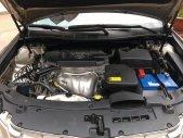Bán Toyota Camry 2.5Q sản xuất 2013, màu vàng, đăng ký tháng 09/2013 giá 900 triệu tại Tp.HCM
