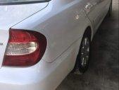 Cần bán lại xe Toyota Camry đời 2003, màu trắng, nhập khẩu nguyên chiếc giá cạnh tranh giá 330 triệu tại Tp.HCM