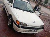 Cần bán Mazda 323 1.6 MT 1995, màu trắng giá 45 triệu tại Hòa Bình