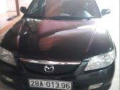 Bán ô tô Mazda 323 đời 2002, màu đen giá 130 triệu tại Hòa Bình