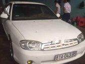 Cần bán Kia Spectra sản xuất 2004, màu trắng, máy êm gầm chắc, côn số ngọt giá 106 triệu tại Gia Lai
