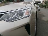 Bán xe Toyota Camry 2.0E năm sản xuất 2015, màu vàng giá 850 triệu tại Tp.HCM