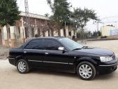 Cần bán xe Ford Laser 2004, màu đen chính chủ, giá tốt giá 175 triệu tại Hà Nội