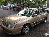 Cần bán Kia Spectra sản xuất năm 2004, màu vàng còn mới giá 95 triệu tại Đồng Tháp