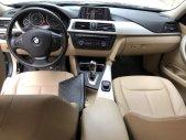 Cần bán BMW 3 Series 320i đời 2012, màu đen chính chủ, 790 triệu giá 790 triệu tại Hà Nội