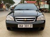 Bán ô tô Chevrolet Lacetti EX sản xuất 2012, màu đen giá 285 triệu tại Thanh Hóa