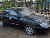 Cần bán Kia Spectra đời 2003, màu đen giá 82 triệu tại Đắk Nông