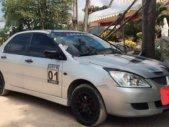Bán Mitsubishi Lancer GaLa 1.6AT năm sản xuất 2003, màu bạc số tự động giá 220 triệu tại Bình Định