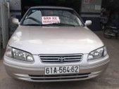 Bán Toyota Camry GLi năm 2001, màu vàng cát, 2 ghế điện giá 215 triệu tại An Giang