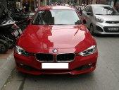 Cần bán xe BMW 320i sản xuất 2012 màu đỏ giá 910 triệu tại Hà Nội