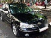 Bán Ford Laser Ghi 1.8 đời 2004, màu đen, xe đẹp giá 186 triệu tại Hà Nội