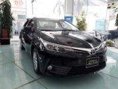 Bán Toyota Corolla altis 1.8E năm sản xuất 2019, màu đen giá 733 triệu tại Hà Nội