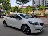Bán xe Kia K3 (2.0 AT) đời 2016, màu trắng, gia đình sử dụng mới 98% giá 549 triệu tại Tp.HCM