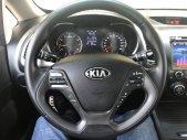 Bán Kia K3 1.6AT màu trắng, số tự động sản xuất 2014 xe đẹp đi ít giá 488 triệu tại Tp.HCM