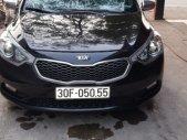 Cần bán lại xe Kia K3 1.6 AT sản xuất năm 2014, màu đen  giá 590 triệu tại Hà Nội