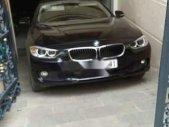 Cần bán lại xe BMW 3 Series 320i 2014, màu đen, xe nhập xe gia đình giá 1 tỷ 20 tr tại Tp.HCM