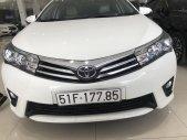 Bán Toyota Corolla Altis 2015, màu trắng giá 630 triệu tại Tp.HCM