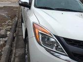 Cần bán xe Mazda BT50 3.2AT 2013 màu trắng máy dầu 2 cầu giá 485 triệu tại Tp.HCM