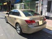 Bán Chevrolet Cruze LS 2011 số sàn màu vàng chính chủ giá 296 triệu tại Tp.HCM