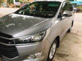 Gia đình cần bán xe Toyota Innova 2.0E 2017 số sàn màu xám bạc giá 675 triệu tại Tp.HCM
