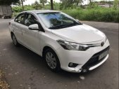 Chính chủ bán xe Toyota Vios 1.5E đời 2014, màu trắng giá 415 triệu tại Tp.HCM