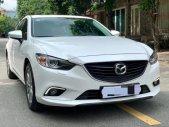 Gia đình đổi xe cần bán Mazda 6 đời 2016, số tự động 2.0, màu trắng giá 667 triệu tại Tp.HCM