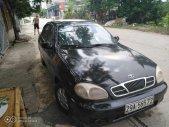 Cần bán lại xe Daewoo Lanos MT sản xuất 2001, màu đen giá 47 triệu tại Ninh Bình