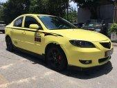 Bán Mazda 3 đời 2004, màu vàng giá 268 triệu tại Bình Dương