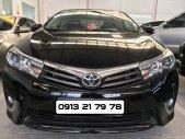 Cần bán lại xe Toyota Corolla altis 2.0V đời 2014, màu đen giá 690 triệu tại Tp.HCM