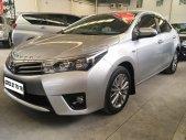 Cần bán gấp Toyota Corolla altis 1.8G đời 2015, màu bạc giá 670 triệu tại Tp.HCM