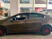 Bán Kia K3 đời 2015, màu nâu chính chủ, giá tốt giá 480 triệu tại Tp.HCM