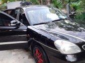 Cần bán Daewoo Nubira II 1.6 năm 2002, màu đen số sàn giá 129 triệu tại Hà Tĩnh
