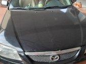 Bán Mazda 323 đời 2003, màu đen chính chủ, giá tốt giá 150 triệu tại Quảng Bình