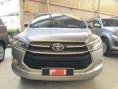 Bán xe Toyota Innova 2.0E năm 2016, màu bạc giá 660 triệu tại Tp.HCM
