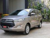 Cần bán xe Toyota Innova 2.0E đời 2018, màu bạc giá 710 triệu tại Tp.HCM